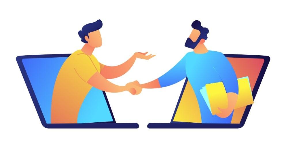 two men shake hands