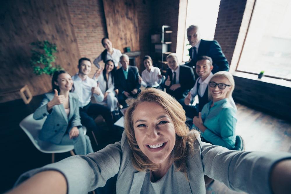 Work colleagues make a selfi together