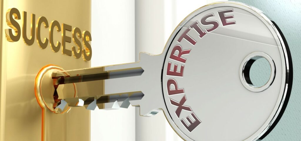 Key with the word expertise engraved halfway into a lock bearing the word success