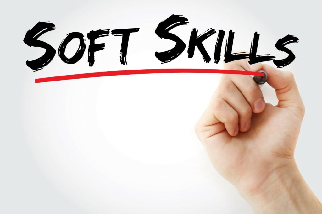 Soft Skills spelled out in black letters, underlined with a red line that is being drawn by a hand