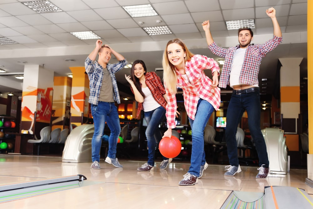colleagues play bowling after work