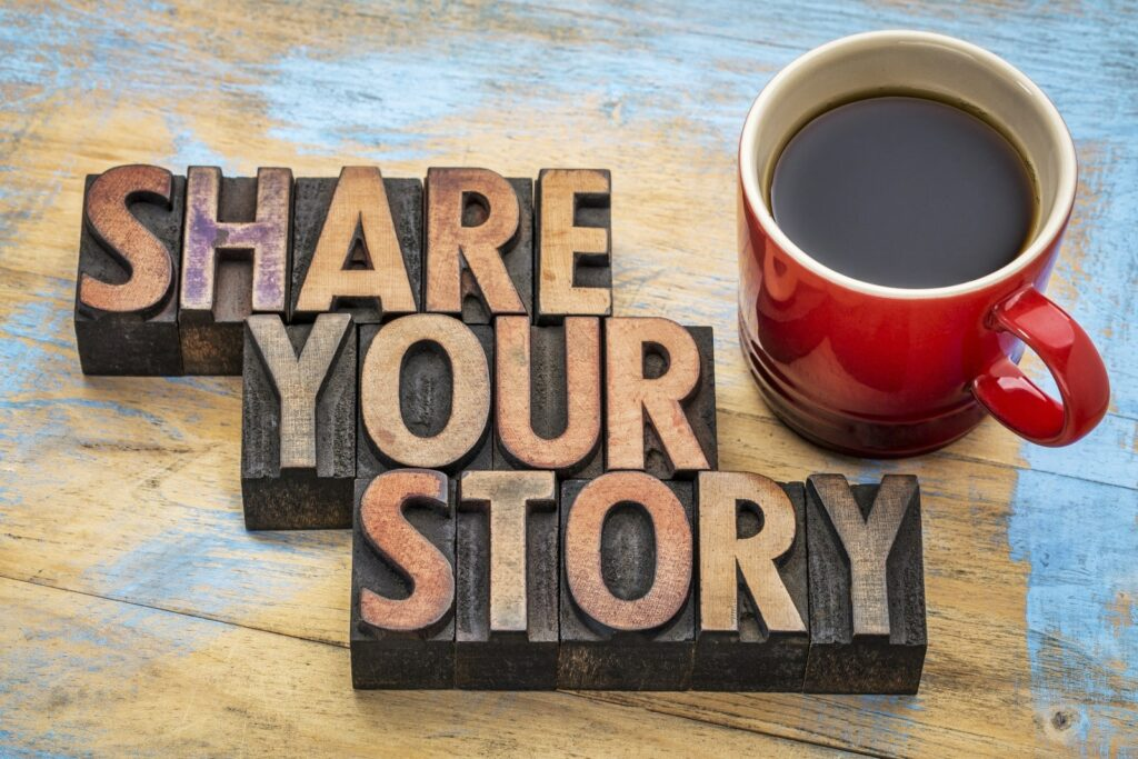 """the words """"share your story"""" laying next to coffee"""