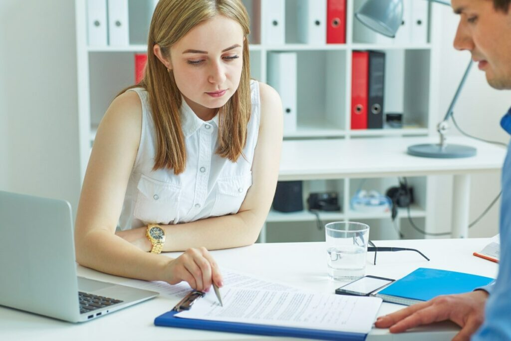 Employment Law - a woman shows a man the employment contract