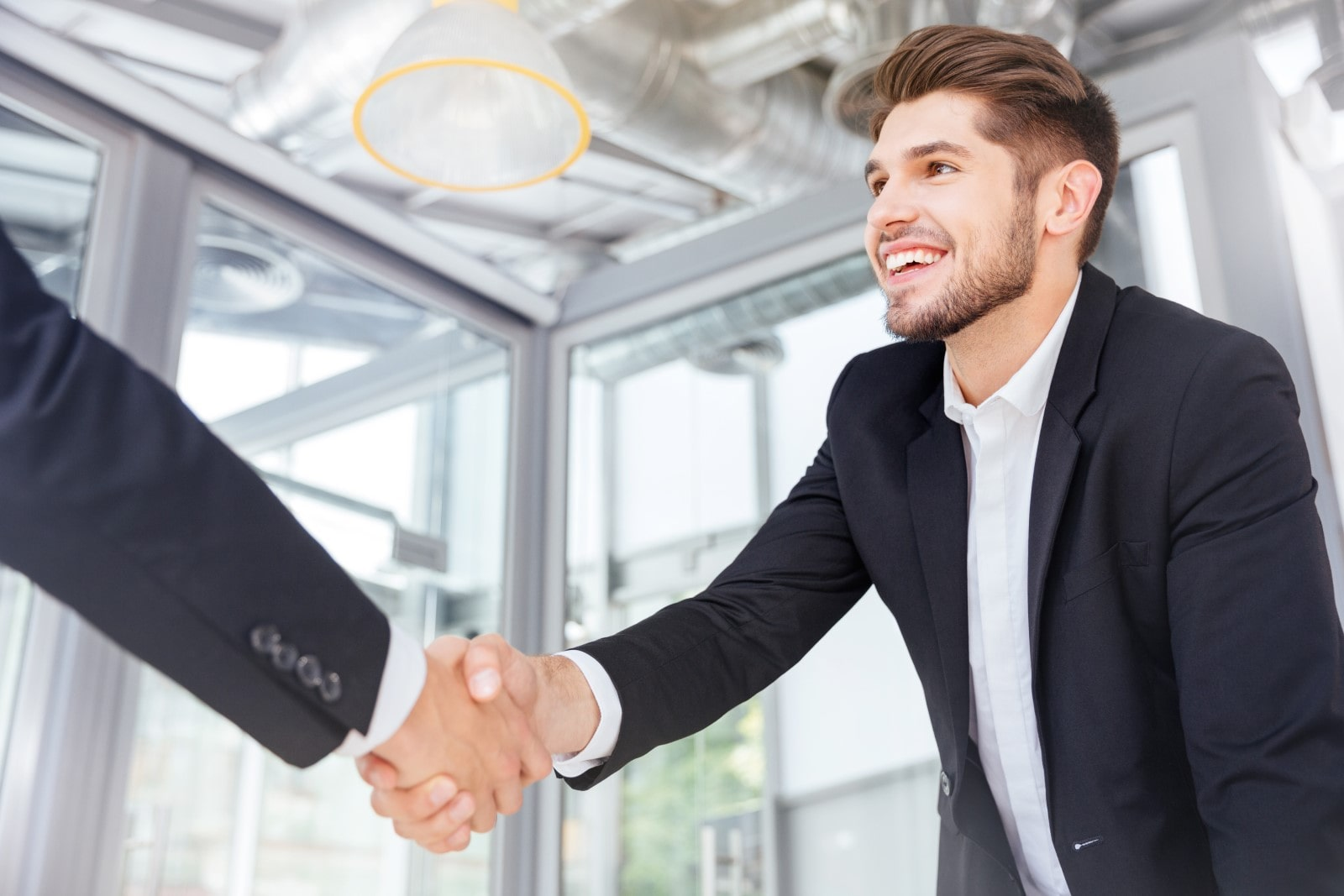 Two guys shaking hands after a job interview
